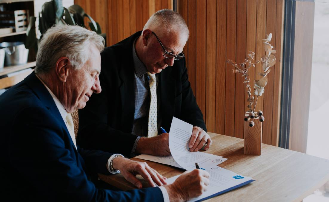 COLLABORATION: Committee for the Hunter chairman Richard Anicich and Hunter Joint Organisation chairman Bob Pynsent sign the Memorandum of Understanding. Picture: Zuela Photography