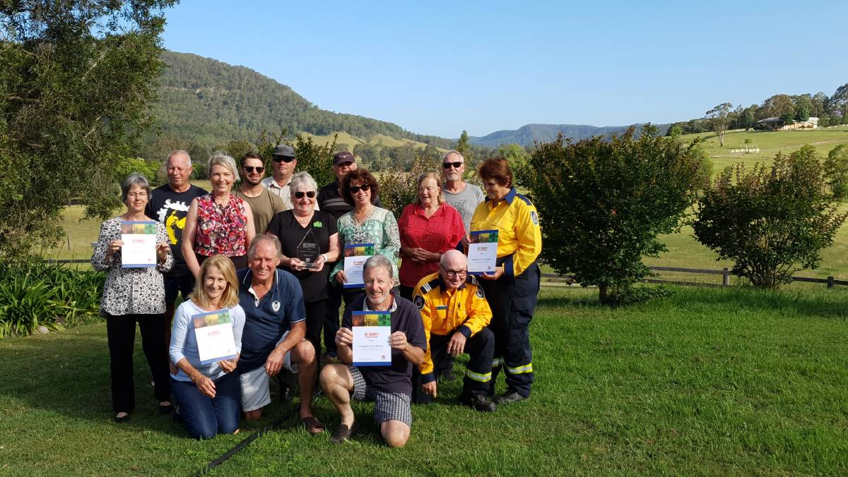 PROUD: Representatives of the Millfield Rural Fire Brigade and the Congewai community, who were named winners of this year's NSW Get Ready Award.