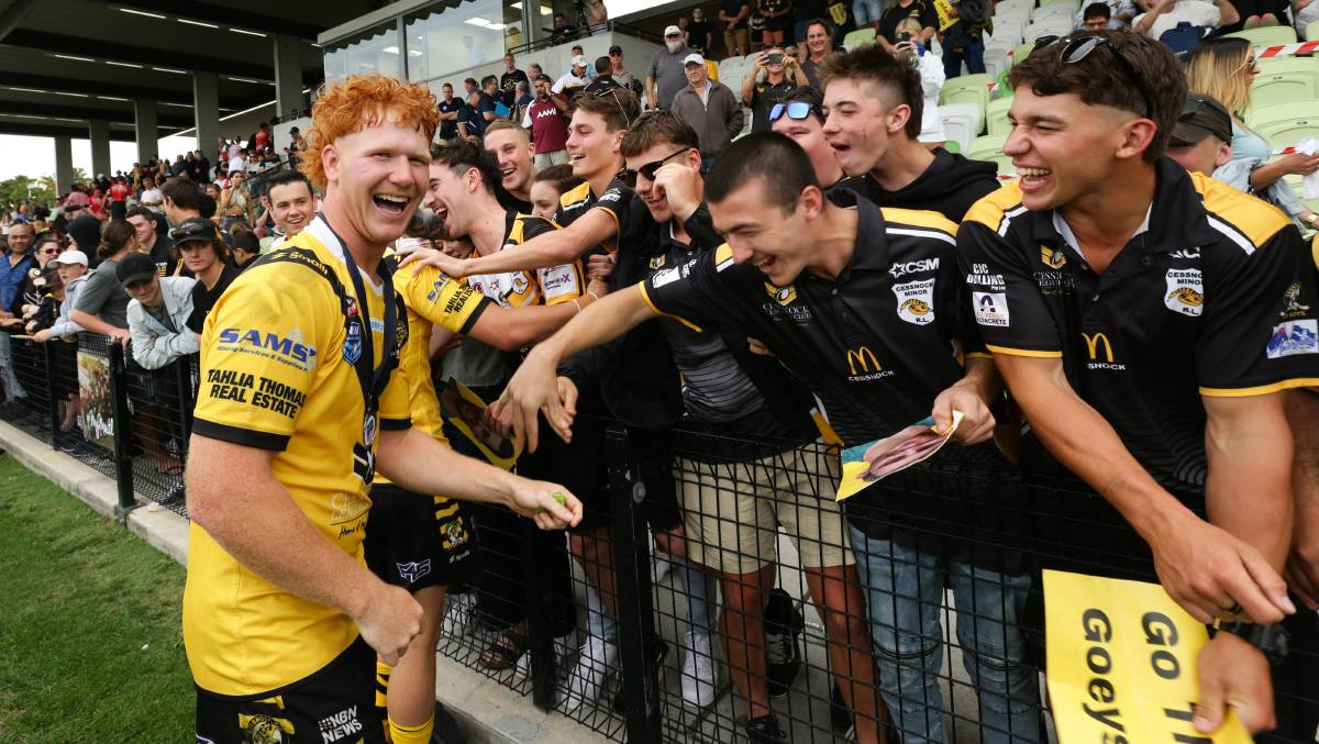 ALL SMILES: Cessnock second-rower Harvey Neville celebrates with Goannas supporters after the grand final triumph against Souths at Maitland Sportsground on October 25. Picture: Jonathan Carroll