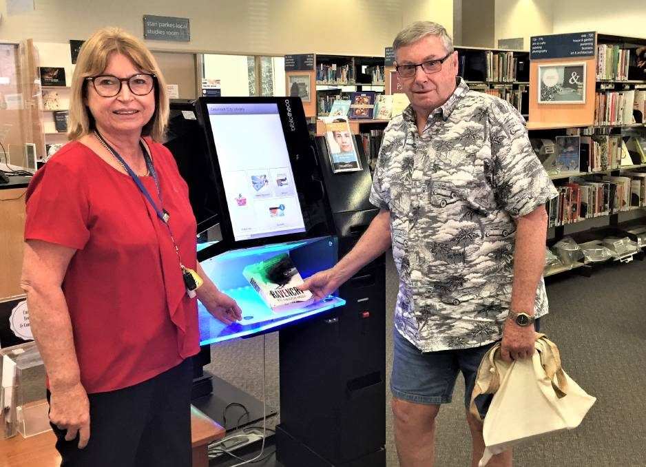 GREATER ACCESS: Library services coordinator Rose-marie Walters and customer Col Chapman at the checkout at Cessnock Library.