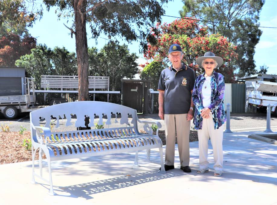 TRIBUTE: Branxton residents Lester and Joy Bootes, with one of the new benches near the town's memorial rotunda, which features the words 'Lest We Forget'.