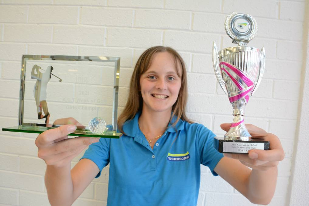 Quedesha Golledge proudly displays her ACT Week of Golf girls and girls 16 years and over trophies. Photo: Scott Calvin.